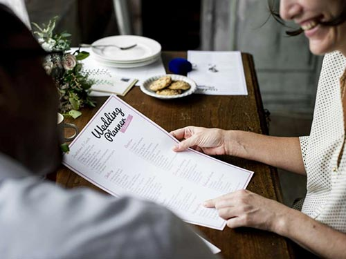 woman viewing a wedding planner menu